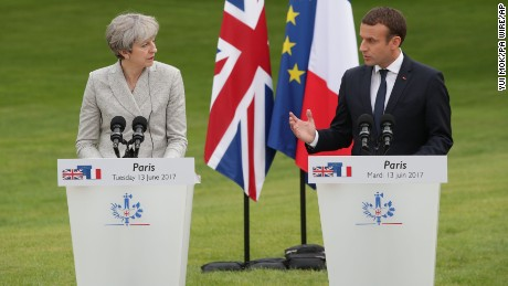 French President Emmanuel Macron and Prime Minister Theresa May speak at a joint press conference at the Elysee Palace on Tuesday.