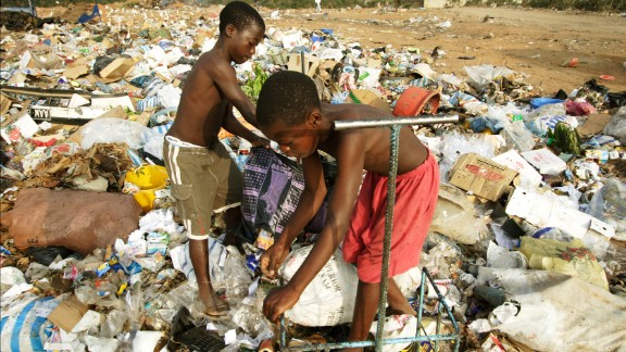Angola: Children collect plastic and cardboard among the trash in Luanda province. Here, more than 10% of children die before their 5th birthdays.