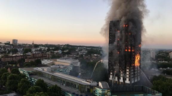 Firefighters battle the massive blaze.