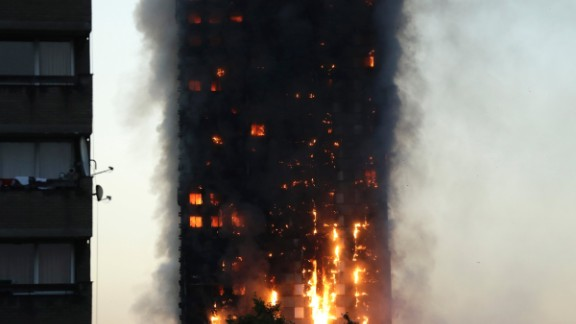 """Witness Michael Kyriakou told CNN the fire spread quickly, with one side of the building ablaze around 15 minutes after it started. """"Within an hour it had engulfed the top part of the building,"""" he said. """"There are people in bathrobes and slippers all around us, so hopefully as many as possible got out."""""""