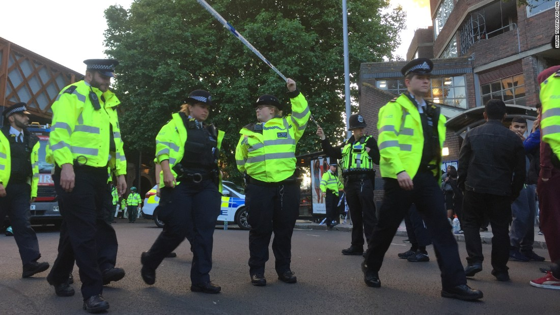 Police officers asked people to step back so they could expand the cordon and make more space for emergency services.