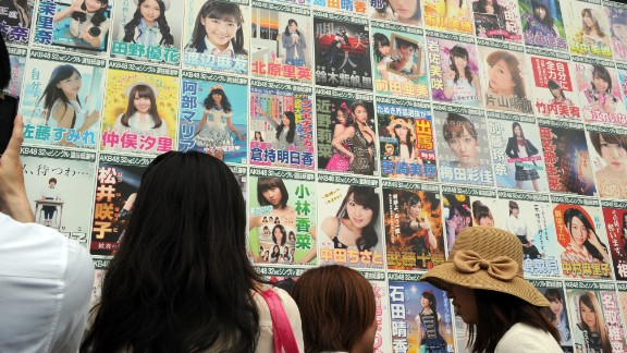 AKB48 fans watch the election campaign posters prior to the group
