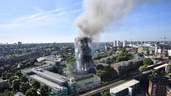 Smoke rises from Grenfell Tower hours after the fire.