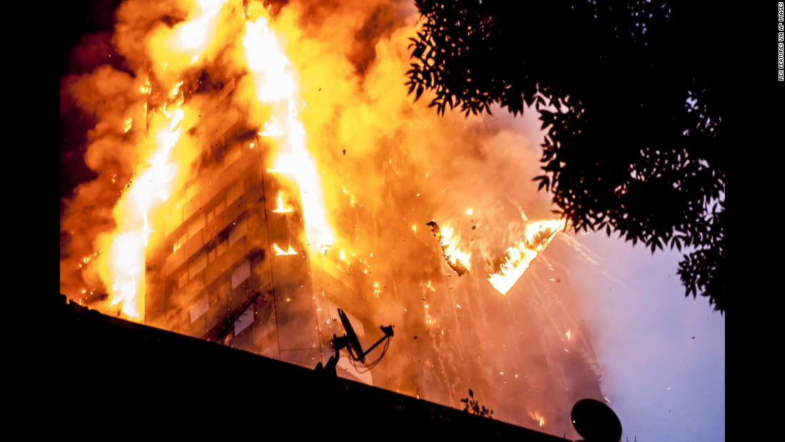 Burning debris falls from the 24-story Grenfell Tower as a massive fire engulfs the London apartment building early on Wednesday, June 14. Dozens of people are dead or presumed dead.