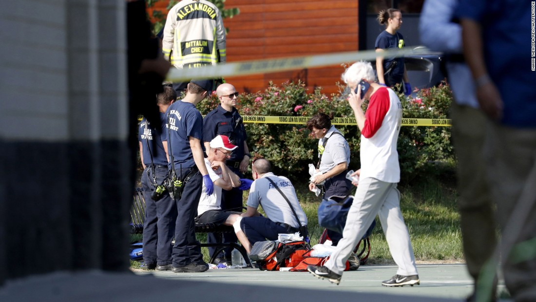 A person is treated by emergency workers at the scene of the shooting.