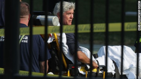 U.S. Rep. Roger Williams is wheeled away by emergency medical service personnel from the Eugene Simpson Stadium Park June 14, 2017 in Alexandria, Virginia. U.S. House Majority Whip Steve Scalise was among five wounded in the attack, including the suspected gunman, as Republican Congressional members practiced for a charity baseball game.