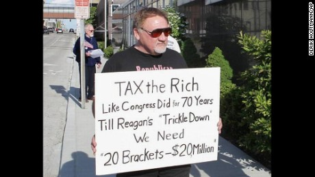 In this undated file photo, James Hodgkinson holds a sign during a protest outside a United States Post Office in Belleville, Illinois.
