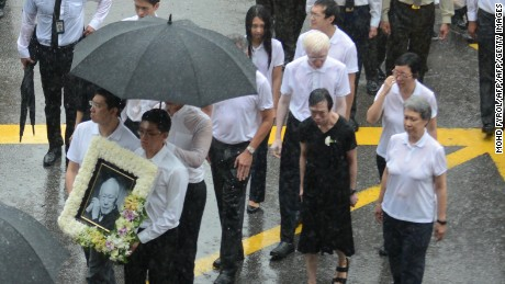 Lee Wei Ling (second from left), the younger sister of Singapore's Prime Minister Lee Hsien Loong, along with family members walking out of parliament house during the late founding father Lee Kuan Yew's funeral procession in Singapore in 2015.