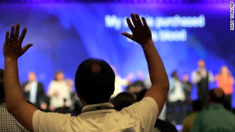 People worship during the Southern Baptist Convention annual meeting.