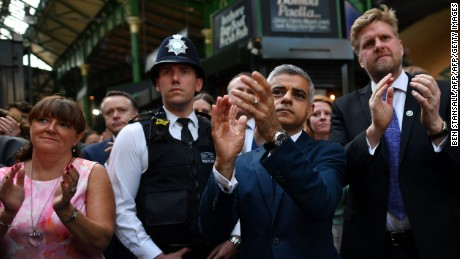 Mayor Sadiq Khan applauds at the re-opening of Borough market before going to see the aftermath of the tower fire.