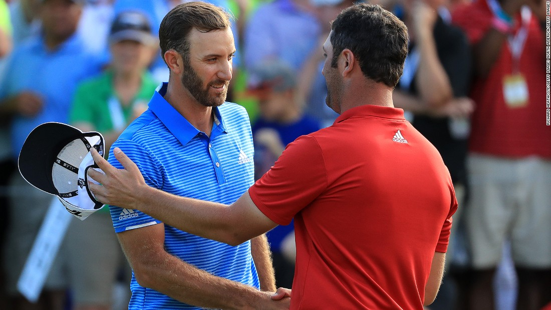 World No. 1 Dustin Johnson shakes hands with Rahm after winning the final match of the World Golf Championships Match Play  at the Austin Country Club in March 2017.