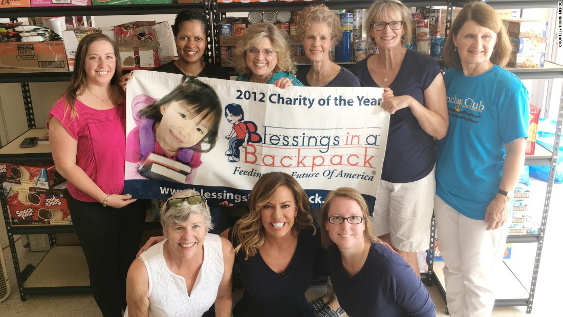 Meade joins the Blessings in a Backpack charity volunteers.