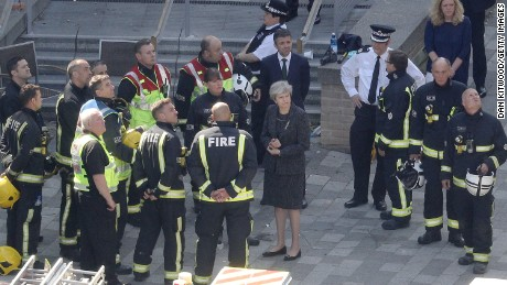 Prime Minister Theresa May was criticized for a low-key visit to the disaster scene.