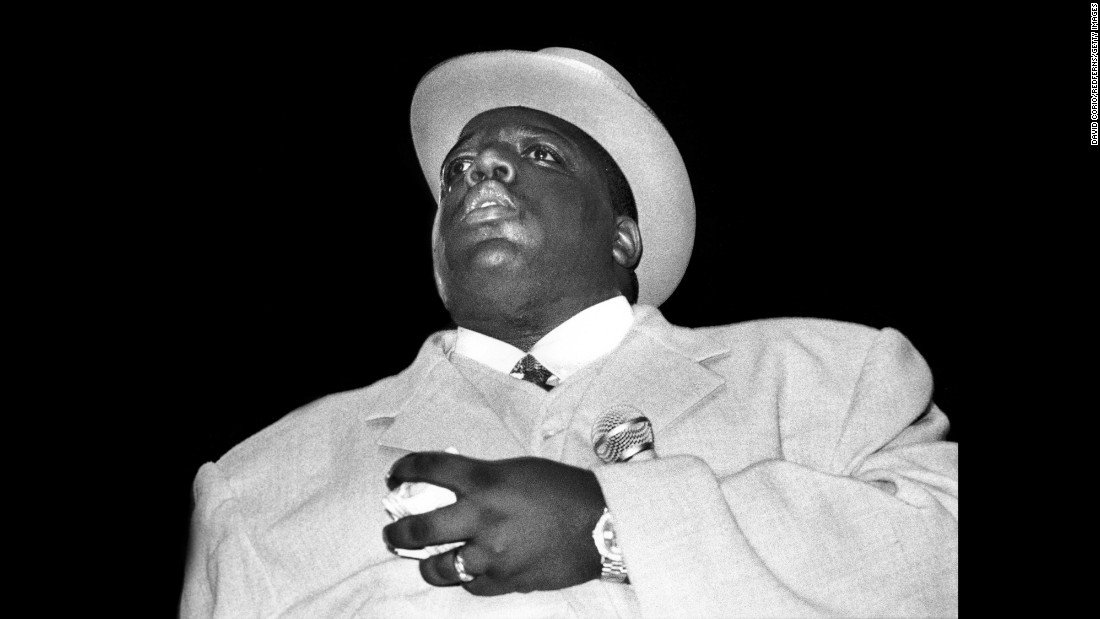 "With hits like ""Big Poppa"" and ""One More Chance,"" <a href=""http://www.cnn.com/2017/03/09/entertainment/notorious-big-20-year-anniversary/index.html"">Christopher Wallace (aka The Notorious B.I.G.)</a> rose to hip hop superstardom in the mid-'90s. Shown here performing on June 29, 1995, Wallace was signed to Sean ""Diddy"" Combs' record label, Bad Boy Records, and was a central figure in the decade's tense East Coast-West Coast hip hop war. Just six months after Tupac Shakur was shot and killed in Las Vegas, Wallace was gunned down in Los Angeles in 1997. And like Shakur's death, Wallace's killing remains unsolved.<br />"