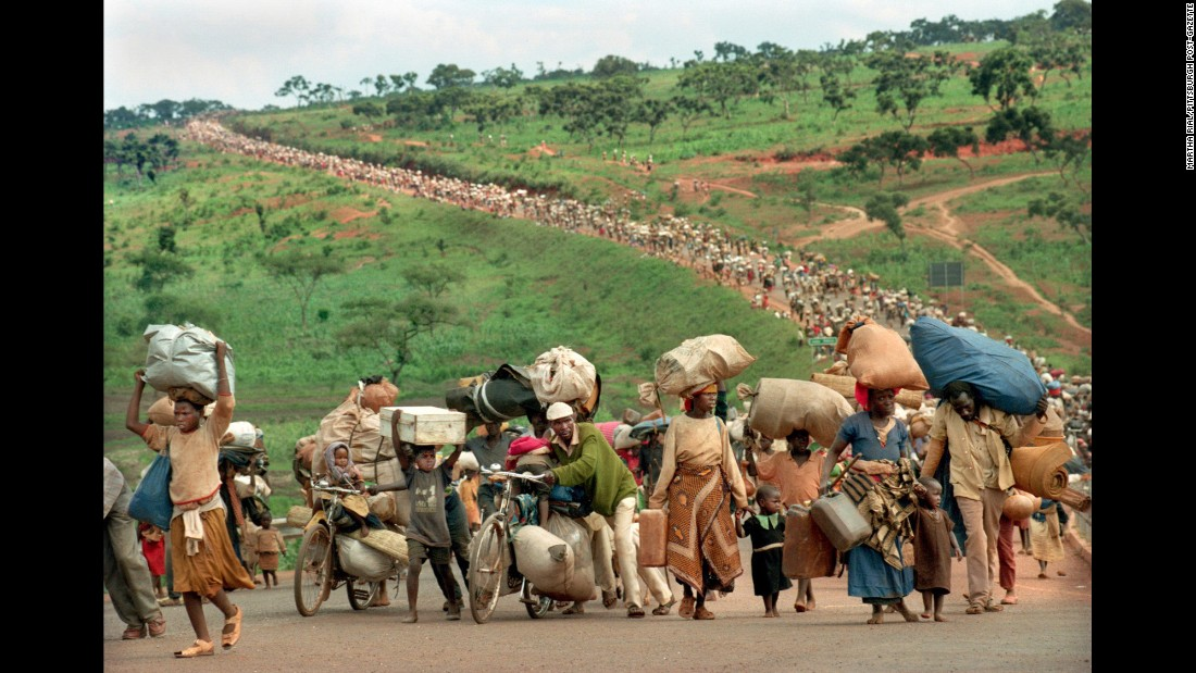 In 1994, violence erupted in Rwanda in horrifying fashion, as Hutu extremists slaughtered an estimated 800,000 people in just 100 days. The impacts of the genocide rippled across the country for years. This Pulitzer Prize-winning photo taken by photographer Martha Rial in December 1996 captured hundreds of Rwandan Hutu refugees migrating with as much as they could carry after they were turned back by Tanzanian soldiers.