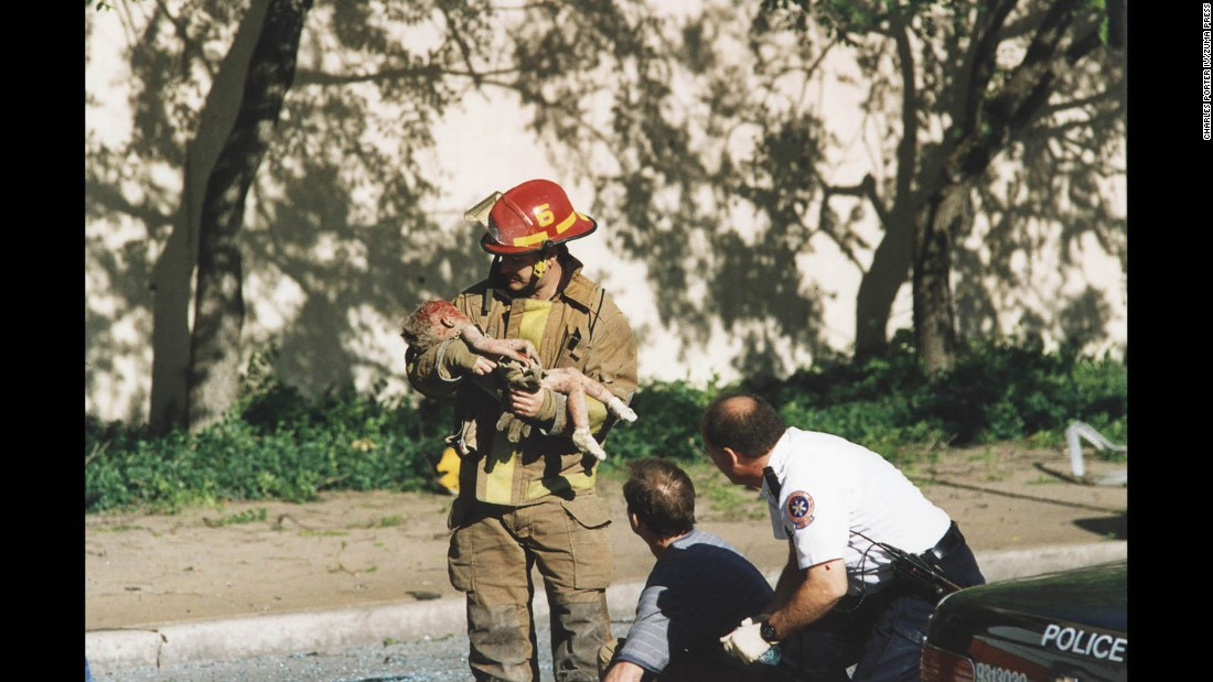 "Just after 9 a.m. on April 19, 1995, a massive fertilizer bomb packed into a rental truck exploded outside Oklahoma City's Alfred P. Murrah Federal Building, <a href=""http://www.cnn.com/2013/09/18/us/oklahoma-city-bombing-fast-facts/index.html"">killing 168 people and injuring more than 500</a>. This photo captured firefighter Chris Fields holding 1-year-old Angel Baylee Almon, who was thrown from the building by the blast. Almon celebrated her 1st birthday the day before the bombing, but later died from her injuries."