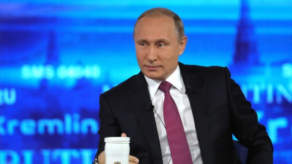 """Russian President Vladimir Putin answers questions at the Gostiny Dvor studio during the annual """"Direct Line with Vladimir Putin broadcast live"""" by Russian TV channels and radio stations in Moscow on June 15, 2017. / AFP PHOTO / SPUTNIK / Mikhail KLIMENTYEV        (Photo credit should read MIKHAIL KLIMENTYEV/AFP/Getty Images)"""