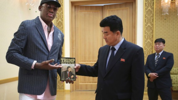 """Former NBA basketball star Dennis Rodman presents a book titled """"Trump The Art of the Deal"""" to North Korea"""