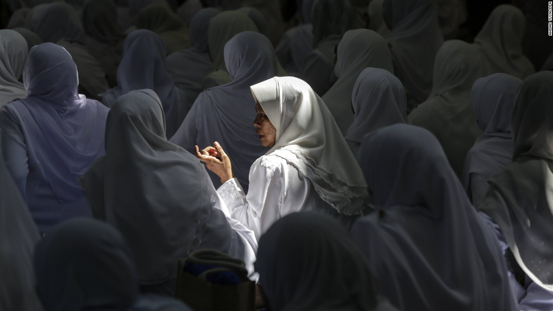 Women chat at a mosque in Kuala Lumpur, Malaysia, during a Quran-reciting program on Sunday, June 11. Ramadan, the most sacred month in the Muslim year, ends on June 24.