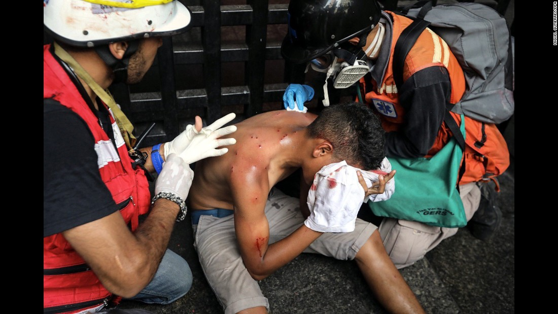 "An injured man receives medical attention during a protest in Caracas, Venezuela, on Monday, June 12. The country's Supreme Court had rejected a chief prosecutor's motion that would prevent President Nicolas Maduro from rewriting the constitution. Venezuela <a href=""http://www.cnn.com/2017/04/12/world/gallery/venezuela-protests/index.html"" target=""_blank"">has been in a state of widespread unrest </a>since March."