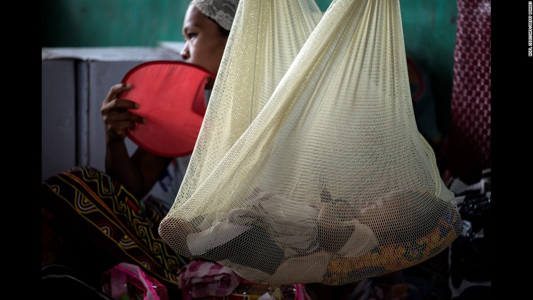 "A woman and her baby rest at an evacuation center in Iligan, Philippines, on Thursday, June 15. They had fled the nearby city of Marawi, where government forces <a href=""http://www.cnn.com/2017/06/12/asia/philippines-isis-marawi-duterte/index.html"" target=""_blank"">have been battling ISIS-affiliated militants.</a>"