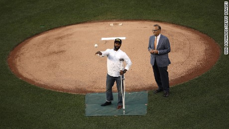 WASHINGTON, DC - JUNE 15:  U.S. Capitol Hill special agent David Bailey (L), who was wounded in yesterday's shooting, throws out the first pitch before the Congressional Baseball Game at Nationals Park on June 15, 2017 in Washington, DC. Bailey and special agent Crystal Griner were assigned to U.S. Rep. Steve Scalise (R-LA) and returned fire during the attack. Scalise is in critical condition following a shooting yesterday during a Republican congressional baseball team practice.  (Photo by Win McNamee/Getty Images)