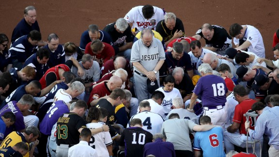 WASHINGTON, DC - JUNE 15:  Members of the Republican and Democratic congressional baseball teams gather for a bipartisan prayer before the start of the Congressional Baseball Game at Nationals Park on June 15, 2017 in Washington, DC. U.S. House Majority Whip Rep. Steve Scalise (R-LA) is in critical condition following a shooting yesterday during a Republican congressional baseball team practice.  (Photo by Win McNamee/Getty Images)