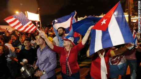 TOPSHOT - Cuban Americans celebrate upon hearing about the death of longtime Cuban leader Fidel Castro in the Little Havana neighborhood of Miami, Florida on November 26, 2016.  Cuba's socialist icon and father of his country's revolution Fidel Castro died on November 25 aged 90, after defying the US during a half-century of ironclad rule and surviving the eclipse of global communism. / AFP / RHONA WISE        (Photo credit should read RHONA WISE/AFP/Getty Images)