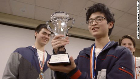 Tuan Bui holds a trophy at the USA memory championships.