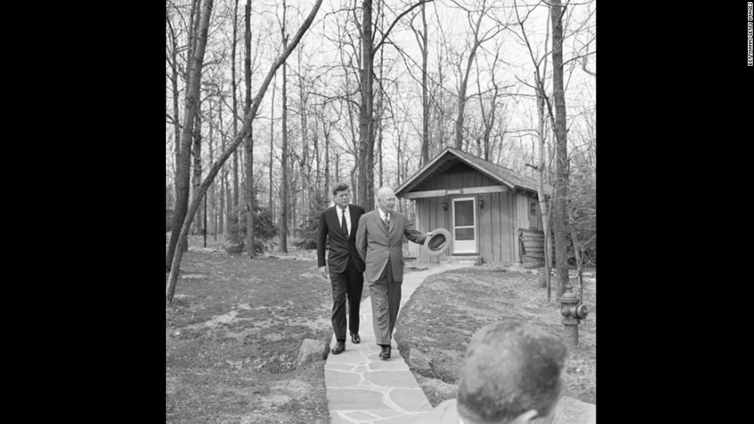 President John F. Kennedy walks the grounds, getting a tour from Dwight D. Eisenhower, as the two discussed Cuba, three months after Kennedy won the election.