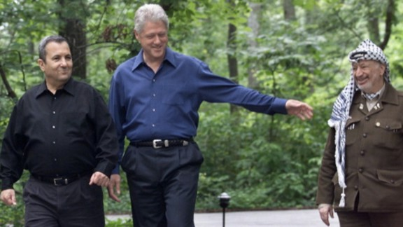 President Bill Clinton walks with Israeli Prime Minister Ehud Barak and Palestinian leader Yasser Aarafat at the Middle East Peace Summit in July 2000.