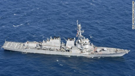 CORRECTS DATE  - The USS Fitzgerald is seen off Shimoda, Shizuoka prefecture, Japan, after the Navy destroyer collided with a merchant ship, Saturday,  June 17, 2017.  The U.S. Navy says the USS Fitzgerald suffered damage below the water line on its starboard side after it collided with a Philippine-flagged merchant ship.  (Iori Sagisawa/Kyodo News via AP)