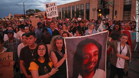 Supporters of Philando Castile held a portrait of Castile as they marched along University Avenue in St. Paul, Minnesota leaving a vigil at the state Capitol on Friday, June 16, 2017. The vigil was held after St. Anthony police Officer Jeronimo Yanez was cleared of all charges in the fatal shooting last year of Castile.