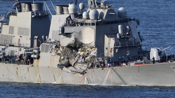 The US Navy guided missile destroyer USS Fitzgerald arrives at the US Naval base, Yokosuka, in the Japanese prefecture of Kanagawa on June 17. The US and Japan launched a major search operation to find seven missing American sailors on June 17 after their navy destroyer collided with a container ship, crushing the side of the military vessel.