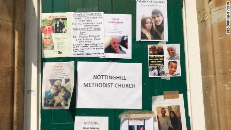 Missing people and informational flyers are posted on a door of the Notting Hill Methodist Church in west London on Sunday 18 June.