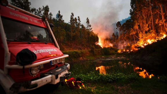 A firefighter rests next to a fire combat truck in Penela, Coimbra, on June 18.