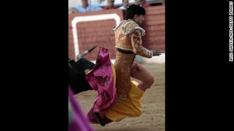 Fandiño gets tripped up in his cape on Saturday. The bull gored him after he fell.