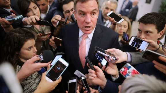 Reporters surround Senate Intelligence Committee ranking member Sen. Mark Warner (D-VA) as he heads for his party's weekly policy luncheon at the U.S. Capitol May 16, 2017 in Washington, DC. Many Republican and Democratic senators expressed frustration and concern about how President Donald Trump may have shared classified intelligence with the Russian foreign minister last week at the White House.