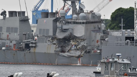 This photo shows damages on the guided missile destroyer USS Fitzgerald at its mother port in Yokosuka, southwest of Tokyo on June 18, 2017.  A number of missing American sailors have been found dead in flooded areas of a destroyer that collided with a container ship off Japan's coast, the US Navy said on June 18, 2017. / AFP PHOTO / Kazuhiro NOGI        (Photo credit should read KAZUHIRO NOGI/AFP/Getty Images)