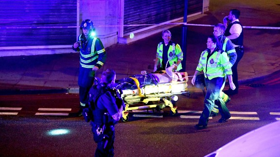 Police and ambulance crews at the scene of the attack on Monday.