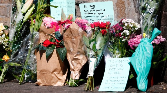 Flowers and tributes lie at a police cordon near the scene of the Finsbury Park attack.