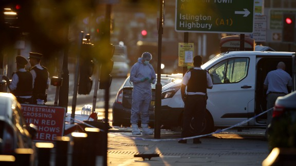 "Forensic investigators work the scene in the Finsbury Park area of north London after a vehicle hit pedestrians on June 19, 2017.  One man was killed and eight people hospitalized when a van ran into pedestrians near a mosque in north London in an incident that is being investigated by counter-terrorism officers, police said on Monday. The 48 year old male driver of the van ""was found detained by members of the public at the scene and then arrested by police,"" a police statement said."