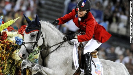 "Laura Kraut of the US rides with ""Cedric"" during the equestrian jumping individual competition in Hong Kong on August 21, 2008 during the 2008 Beijing Olympic Games.       AFP PHOTO / DDP / DAVID HECKER  (Photo credit should read DAVID HECKER/AFP/Getty Images)"