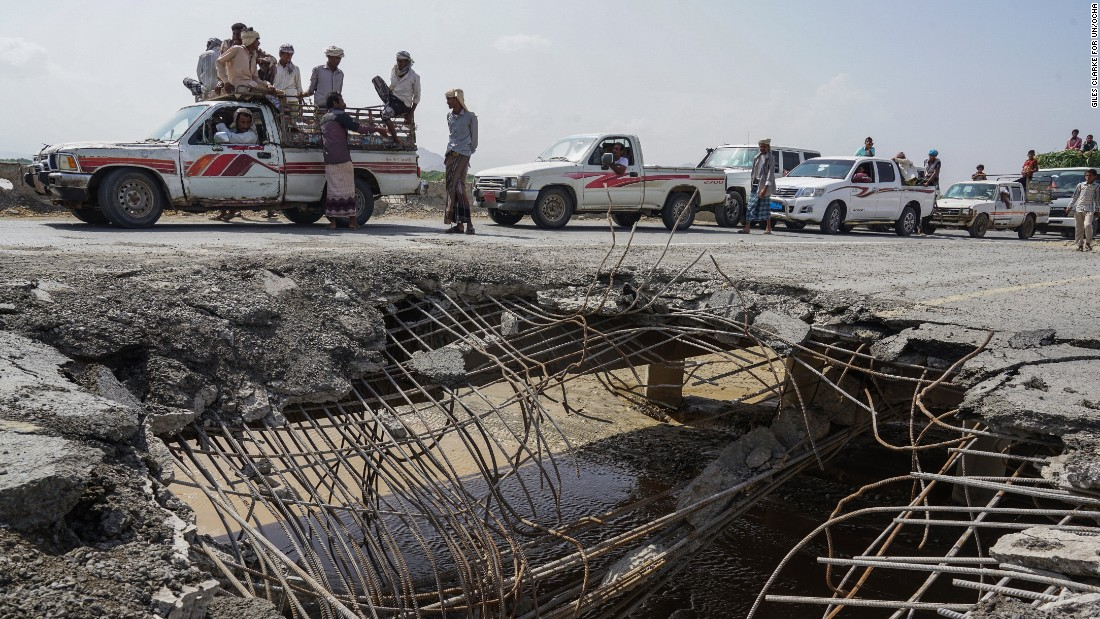 Cars and trucks wait in line to pass over a bridge that was hit by an airstrike in 2016 -- one of just four roads linking Al Hudaydah with the rest of the country.