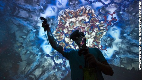 LOS ANGELES, CA - JUNE 13: A man tries out a Virtual Reality game inside a Fulldome.pro 360-degree projection dome on opening day of the Electronic Entertainment Expo (E3) at the Los Angeles Convention Center on June 13, 2017 in Los Angeles, California. The computer and video game trade show draws an international crowd of industry members and fans, and runs June 14 through 16.  (Photo by David McNew/Getty Images)