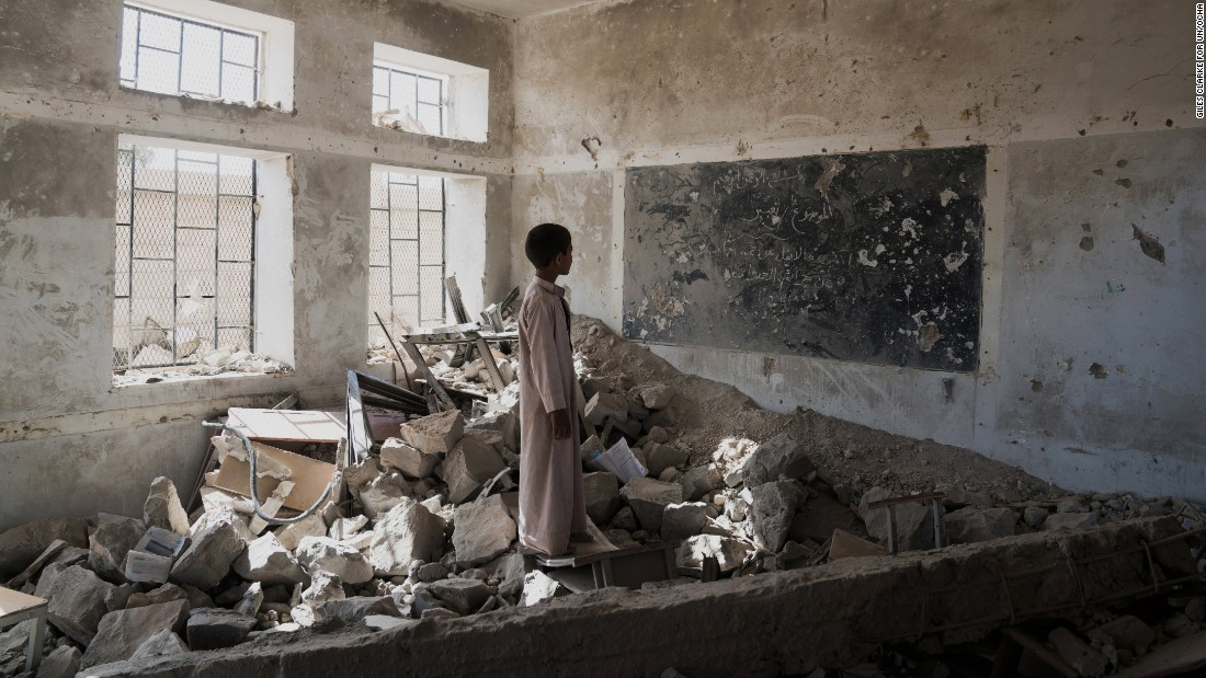 A student at the Aal Okab school stands in the ruins of one of his former classrooms. He and his fellow pupils now attend lesson in UNICEF tents nearby.