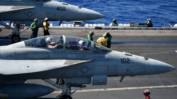 """An F/A-18E and An F/A-18F (front) Super Hornet stand ready on the US navy's super carrier USS Dwight D. Eisenhower (CVN-69) (""""Ike"""") in the Mediterranean Sea on July 7, 2016.  The US aircraft carrier is deployed in support of Operation Inherent Resolve, maritime security operations and theater security cooperation efforts in the US 6th Fleet area of operations. Air Wings embarked aboard conducted strikes against the terrorist group ISIL in Libya, Iraq and Syria.  / AFP / ALBERTO PIZZOLI        (Photo credit should read ALBERTO PIZZOLI/AFP/Getty Images)"""