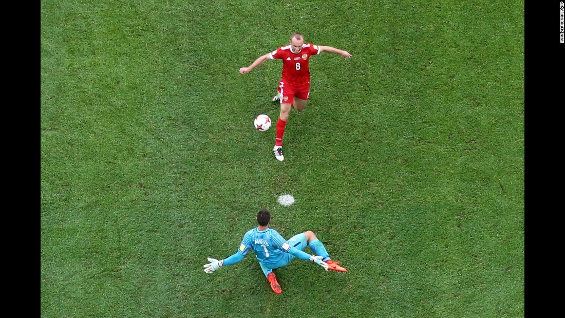 "Russia's Denis Glushakov chips the ball over New Zealand goalkeeper Stefan Marinovic during the opening match of the <a href=""http://www.cnn.com/2017/06/16/football/russia-confederations-cup-portugal-ronaldo/index.html"" target=""_blank"">Confederations Cup</a> on Saturday, June 17. The ball was eventually bundled in for a goal, and Russia won 2-0."