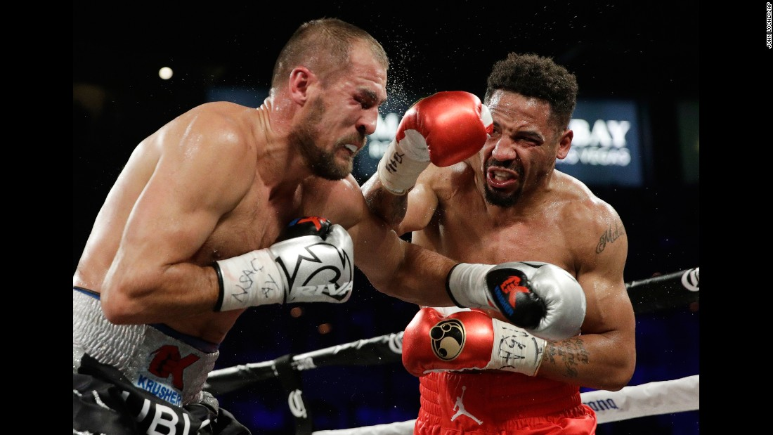 Andre Ward punches Sergey Kovalev during their light-heavyweight title fight on Saturday, June 17. Ward stopped Kovalev in the eighth round to remain undefeated.