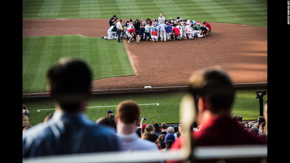 "A prayer is held on the field before the start of the Congressional Baseball Game on Thursday, June 15. Democrats and Republicans <a href=""http://www.cnn.com/interactive/2017/06/politics/congressional-baseball-game-cnnphotos/index.html"" target=""_blank"">played the annual charity game</a> just a day after a gunman opened fire at a GOP practice, injuring US Rep. Steve Scalise and several others."